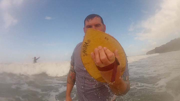A new fan to bodysurfing in Pembrokeshire, Wales, UK, testing out wooden bodysurfing handplanes - For sale online