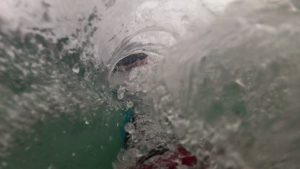 December bodysurf, tucking in to a small barrel, Pembrokeshire, Wales