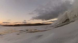November sunset bodysurf, waves and moon captured together, Newgale beach, Pembrokeshire, Wales