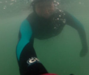 December bodysurf, duckdiving in clear cool water, Pembrokeshire, Wales
